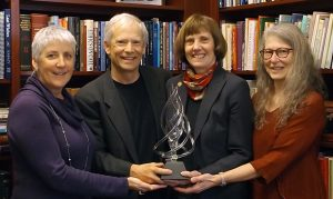 Holding the Flame of Excellence award: Margaret Carley, JD, Patrick Dunn, MD, Susan Tolle, MD, Terri Schmidt, MD